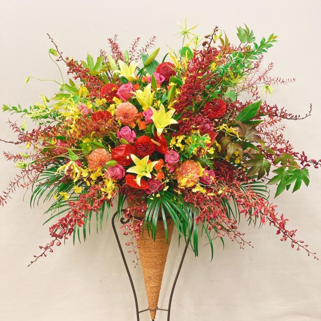 赤黄色オレンジのコーンスタンド花(H180)